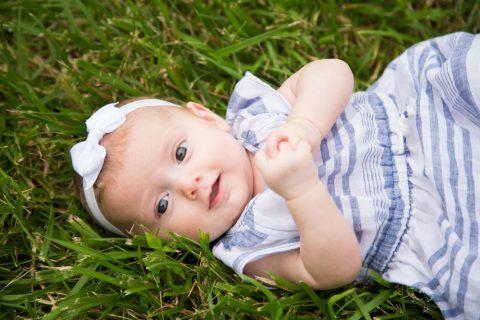 Three month old portrait in grass