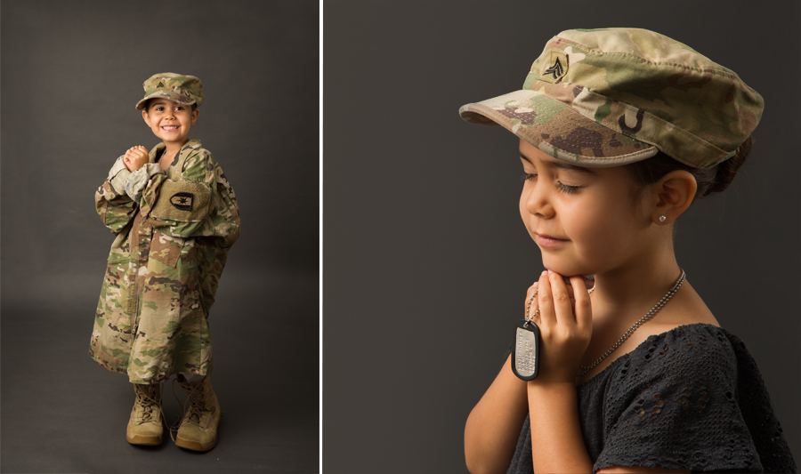 child of soldier posing in his uniform