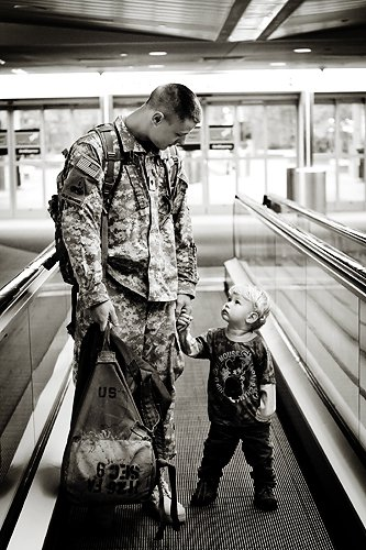soldier and son at airport